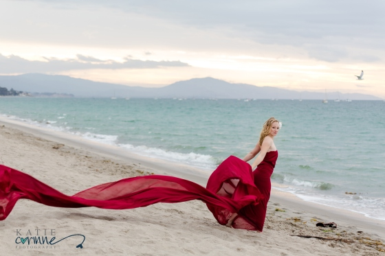 girl on beach at sunrise with flowy fabric on beach of Santa Barbara, CA