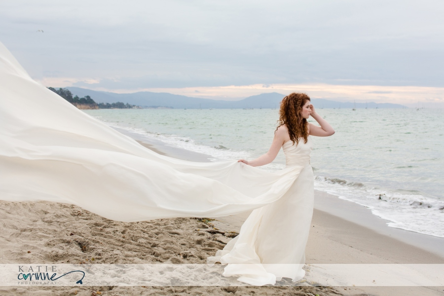 Whimsical beach Destination wedding photographer for Bahamas, California, bride on beach at sunrise with flowy fabric on beach of Santa Barbara, CA