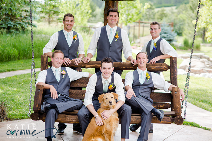 Awww cute adorable photo of Groom with his dog on the wedding day. Furbaby is ringbearer and sits with groomsmen on swing in pose. Wedding at Spruce Mountain Ranch in Larkspur Colorado Ryan loves Corie Photos by Katie Corinne Photography
