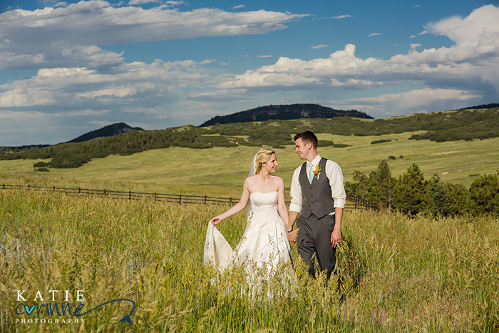 wedding couple in field in Colorado, Devil's Thumb wedding day images, Spruce Mountain Ranch wedding day images, Summer wedding at Colorado ranch, Club at Flying Horse wedding day images